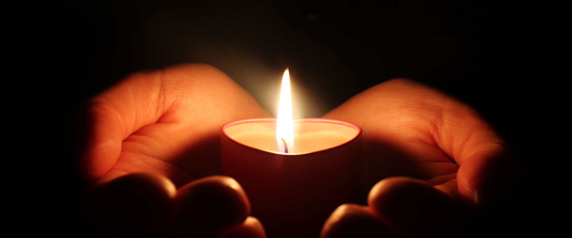 Hand Held Candle in The Dark